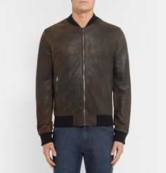 This <a href='http://www.mrporter.com/mens/Designers/Dolce_and_Gabbana'>Dolce & Gabbana</a> bomber jacket looks like a cool heirloom. It has been expertly crafted in Italy from supple brown leather - the distressed treatment gives it the feel of an old favourite that's been handed down through the generations. Wear yours over any casual look for an instant lift.