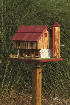 Amish Barn Bird Feeder with Silo from DutchCrafters Amish Furniture.  Invite wild birds to a barn dance like no other with this bird feeder! Designed after traditional Amish barns - complete with a grain silo. Includes removable Roof for easy filling and cleaning, and 4x4 post bracket for mounting. #birdfeeder #cute #backyard #wooden #garden.
