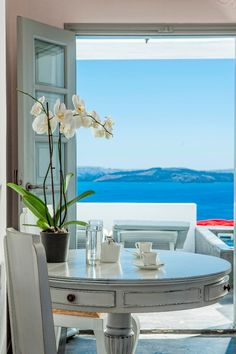 Tea with a view at Alta Mare by Andronis, Santorini - Greece.