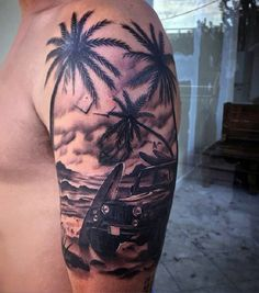 Amazing and well detailed grayscale beach tattoo on the arm. The design features a card and surfboard, both resting on the shore as the peaceful beach wind flies by along the palm trees.