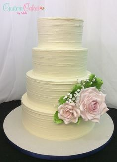 Wedding cake with horizontal ridge texture and sugar roses