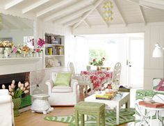 """{A Bright and Bold Summer Beach House}  Living with Bright Colors  """"My style of decorating is, 'I love this, I love that, let's put it all together and make it work,'"""" Ewart says. """"I'll mix polka dots and prints, all shades of green."""" In the living–dining area, a vintage coffee table and stools in Hable Construction's Sweet Pea Beads sit on a zebra-print rug by Jonathan Adler. The embroidered tablecloth, from Mexico, is available at Jacaranda Home."""