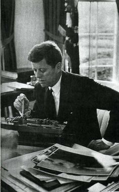 jfk in oval office. jfk indicating where he was at the helm time of collision with oval officeamerican jfk in office