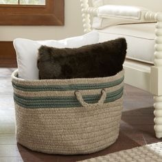 Jansen Storage Basket, Sage | With its rounded, flexible shape, this basket is ideal for storing extra blankets, pillows and other everyday essentials. Handcrafted from a cotton blend, it's both charming and functional.