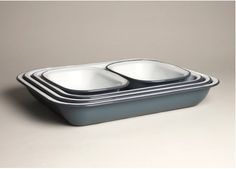 AKE SET  A five-piece enamelware bake set, made by Falcon. For sale in white and pigeon grey, the set includes 1 x 37cm bake pan, 1 x 34cm bake pan, 1 x 31cm bake pan, 2 x 20cm pie dishes.    Since the 1920s Falcon Enamelware has been an icon of British home life.