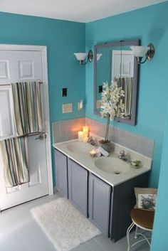 Summer project for the girls bathroom.  Blue paint with black  white decor!