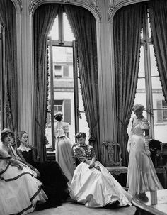 September 1948 by Cecil Beaton    Models are wearing evening gowns by Jacqueline Vienne, Rahvis, Victor Stiebel and Bianca Mosca for British Vogue.