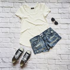 Distressed denim short and a chic tee with modern cut-out details creates an effortless street-style look that's perfect for spring! #eclipsestyle spring, summer, cut out, ribbed, fashion, ootd, whatiwore, crochet, aviators, shorts, converse, edgy