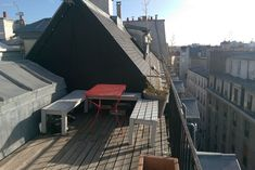 Entire home/apt in Paris, France. Large family room with vaulted ceilings and mezzanine. Fireplace, balcony, and rooftop terrace off . Paris Apartment Rentals, Paris Apartments, Rental Apartments, St Denis, Large Family Rooms, Rooftop Terrace, Paris France, Beams, Adventure