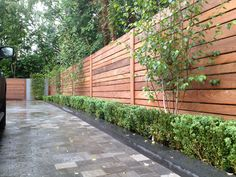 Front driveway with bespoke fencing, Birch, Box & Basalt paving.