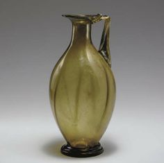 A ROMAN GLASS JUG - CIRCA LATE 3RD-4TH CENTURY A.D.