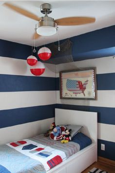 Get inspired by this creative, nautical-themed boy's room. Your toddler will love the bold striped-wall and DIY buoys made out of paper lanterns. Make your little one feel at home in his big kid room with homemade artwork and space for all his favorite toys and books. Learn how you can design your child's room today.