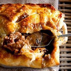 Rich, meaty steak and mushroom stew topped with golden, flaky pastry. This steak and mushroom pot pie is the personification of comfort food. Steak And Mushroom Pie, Steak And Mushrooms, Stuffed Mushrooms, Mushroom Stew, Steaks, Meat Recipes, Cooking Recipes, Recipies, Curry Recipes