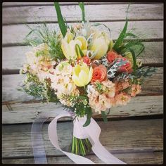 Bouquet of parrot tulips, stock, spray roses,   lacey miller, waxflower and explosion grass