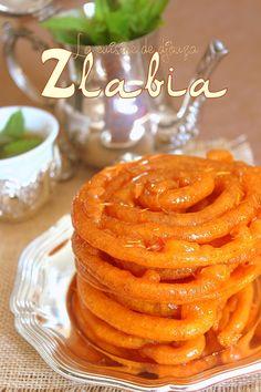 recette de Zlabia ou zlabya, une patisserie orientale au miel de couleur orange, ce gâteau phare du ramadan d'origine tunisienne est facile à faire