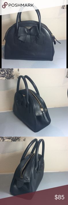 """Kate Spade ♠️ Satchel bowling bag bow detail Beautiful bag with a bow detail black color with a main closure zipper top , the bag is missing the shoulder strap and one of the hardwares that hold the shoulder strap other than that the bag it's in great condition , size 10"""" L x 8.5"""" H x 4"""" W , strap drop 4"""" kate spade Bags Satchels"""