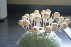 place wooden beads on toothpicks and use masking tape or tin foil to keep from sliding; paint