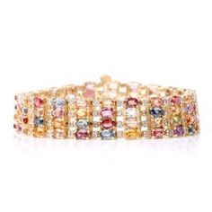 Estate Diamond Sapphire Gold Link Bracelet This enchanting link bracelet is embellished with Diamonds and Multi Colored Sapphires and is crafted in solid Yellow Gold. Gold Link Bracelet, Link Bracelets, Beaded Bracelets, Antique Bracelets, Sapphire, Bangles, Diamond, Antiques, Jewelry