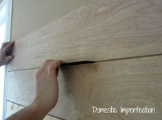 How to make a plank wall from plywood (first, let the hardware store do the cutting).  Though I think that I will prime the boards front and sides before it goes up.  http://www.domesticimperfection.com/2012/08/how-to-make-a-plank-wall/