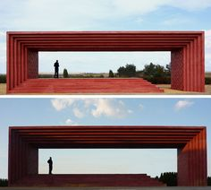 This red monument was designed to use the landscape to create a look similar to a scene in a movie.