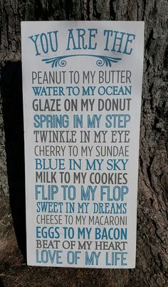 """9"""" x 28"""" wooden sign This delightful sign uses cute comparisons to let the one you love know just how muchin a fun and whimsical way! Blue and grey lettering w"""