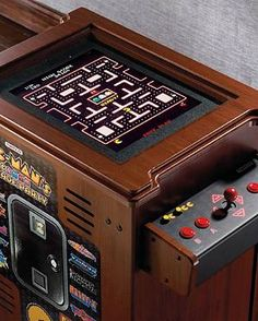 Add vintage fun to your game room without sacrificing your home's style with the Pac-Man 13-game Arcade Cocktail Table that's sure to keep guests entertained for hours.