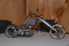 Scrap Metal Chopper   Dimensions: 14.5 x 6 x 5 Weight: 5 lbs   This is a handmade chopper made in the USA from various pieces of scrap metal. The motorcycle is tig welded using silicon bronze filler wire. Once welded the motorcycle was sandblasted, polished, and then clear coated. The motorcycle is made from various size nuts, bolts, steel tubing, sheet metal, conduit nuts, copper plasma cutting consumables, and a hammer formed sheet metal gas tank.