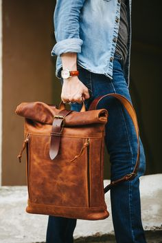 As cool and classic as the original, the newly designed Vintage Deluxe Roll Top Backpack features a smart new look to match your one-of-a-kind style. FYI! Features 100% genuine cowhide leather, pass t
