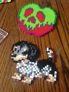 My silver dapple mini daschund perler beads and the poison apple from Snow White