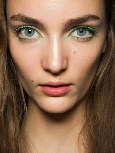 How-to: The bright green eyeliner at Kenzo S/S '13 http://beautyeditor.ca/2013/02/06/how-to-the-bright-green-eyeliner-at-kenzo-ss-13/
