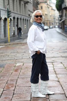 "emi vicensini, 70 years old. ""every woman should have their own style to bring out their unique personality"". she couldn't resist the white fringe boots by Ballin."