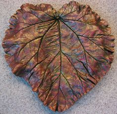 Beautiful concrete cement leaf casting using a rhubarb leaf, custom . Concrete Crafts, Concrete Art, Concrete Projects, Backyard Projects, Garden Projects, Cement Leaf Casting, Concrete Leaves, Painting Cement, Seashell Painting