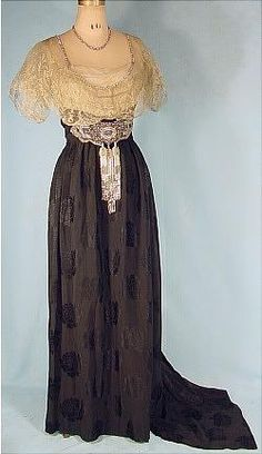 . 1911 Black Jacquard Silk and Metallic Net Lace Trained Evening Gown Trimmed in Rhinestones, Finished with Heavy Beaded Triple Tassel Ornament.
