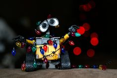 Wall-e is trying to help decorate for Christmas but he's a little tangled up at the moment. I'm thinking of doing a wall-e christmas card this year and this might be one of the options. Disney Love, Disney Magic, Disney Art, Disney Pixar, Disney Films, Walt Disney, Christmas Mood, Disney Christmas, Xmas