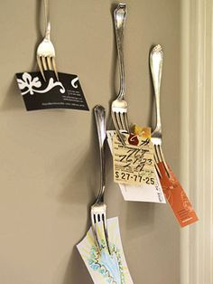 Forks for holding items up. I love the idea of hanging printed out recipes from a fork on a kitchen wall.