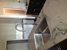 Franke Faucet and sink! Surrounded by white Macaubus quartzite!!