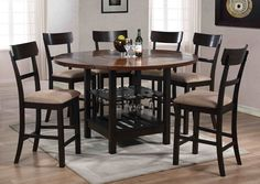 Furnish your dining room with a high top table and stool set that offers an inviting feel. This round, counter height table features sabered...