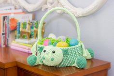 Easter with a bit of hop! All ages will enjoy a Dragon Easter Basket for collecting dragon eggs or for a nice storage basked for toys. Easter Baskets To Make, Easter Crafts For Kids, Easter Stuff, Lion Brand, Easter Crochet, Crochet Baby, Holiday Crochet, Ravelry, Toy Storage Baskets