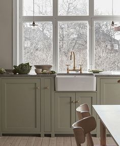 Nordiska Kök - The Classic Shaker kitchen is the natural heart of this beautiful home. Handmade in our carpentry in Gothenburg and handpainted in a pale sage green color, with a limestone countertop. More kitchen inspiration visit www. Shaker Style Kitchens, Shaker Kitchen, Kitchen And Bath, Home Kitchens, Nordic Kitchen, Rustic Kitchen, Kitchen Dining, Kitchen Decor, Country Kitchen