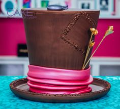 I'm MAD about CAKE! My Mad Hatter's Hat Cake is layers of chocolate cake sandwiched with chocolate ganache, and wrapped in chocolate fondant. Hand painted metallic details give it an extra bit of Alice In Wonderland whimsy! This cake is tea party ready! #Baking #Dessert