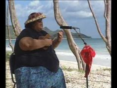 "Check out authentic, live Hawaiian music. YouTube clip of the awe-inspiring Israel Kamakawiwo'ole singing ""White Sandy Beach""."