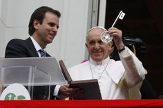Pope Francis holds up key to Rio de Janeiro, from balcony of city hall during visit to Brazil for World Youth Day  Pope Francis holds up key to city of Rio de Janeiro, from the balcony of city hall. At left is Rio Mayor Eduardo Paes. The gift was given July 25 during the pope's weeklong visit to Brazil for World Youth Day. (CNS photo/Paul Haring)