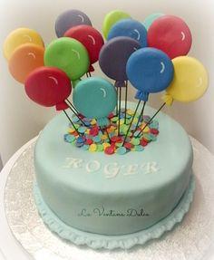 Esta tarta la hice para el primer cumpleaños de Roger. Una tarta con muchos colores, alegre, muy alegre! Llena de globos y confeti de ...