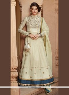 An superb cream tussar silk anarkali salwar kameez will make you look highly stylish and graceful. This gorgeous attire is showing some fantastic embroidery done with embroidered and patch border work...
