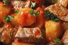 stew with vegetables in a tomato macro. view from above horizontal. background