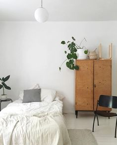 Simple white bedroom, mid century wardrobe