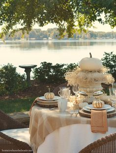 Lakeside fall table with white pumpkins and Mikasa Parchment Engraved dinnerware…