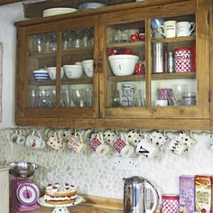 Hanging storage    Hang a selection of mugs underneath the cupboards in a country-style kitchen. This is a clever and cheap way of using space and adding to the rustic aesthetic.