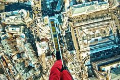 No safety net: Mustang tentatively places one foot in front of the other as he steps across a brick ledge at the top of one of the Ukraine's tallest buildings