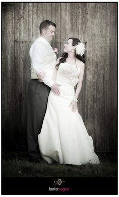 image of bride and groom in front of barn at millcreek barn.  borterwagner photography http://www.borterwagner.com/